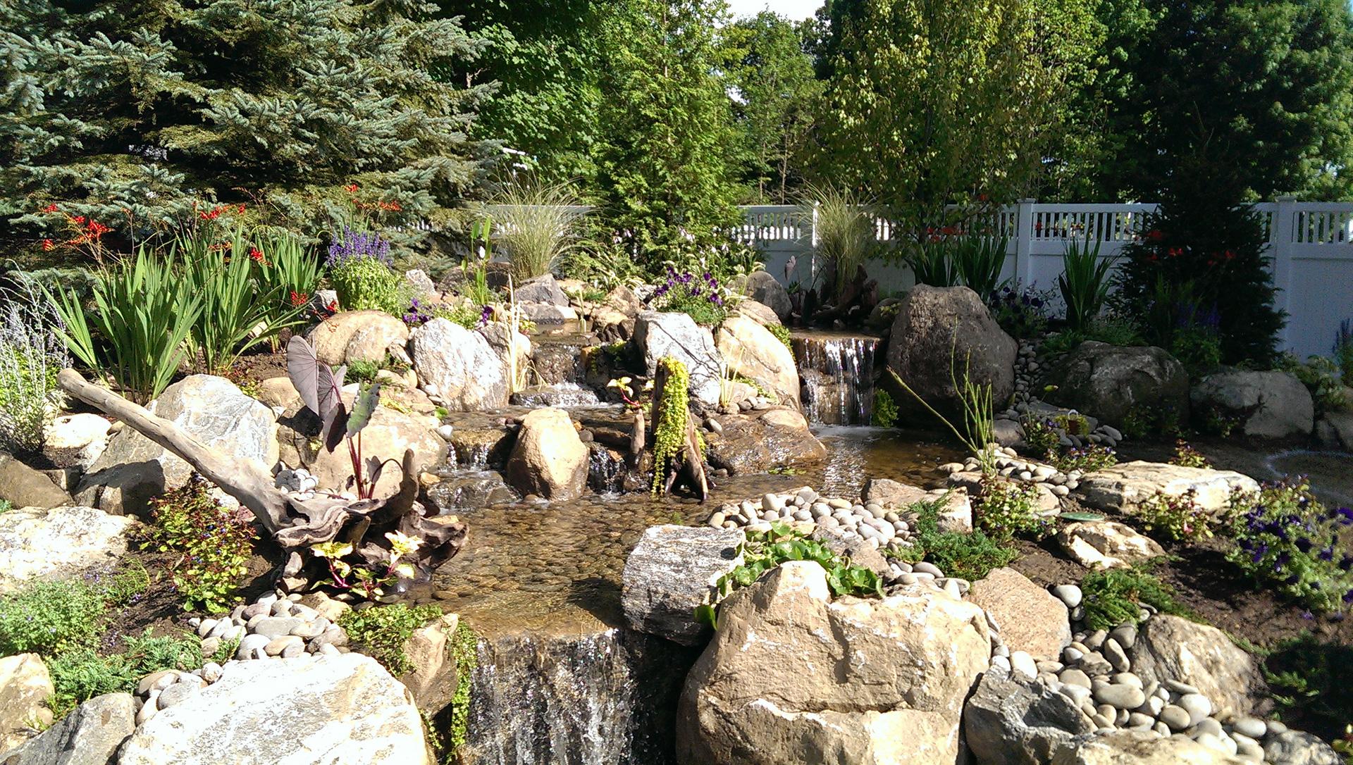 AquaScapes East Landscaping, Pond Contractor and Landscape Design slide 1
